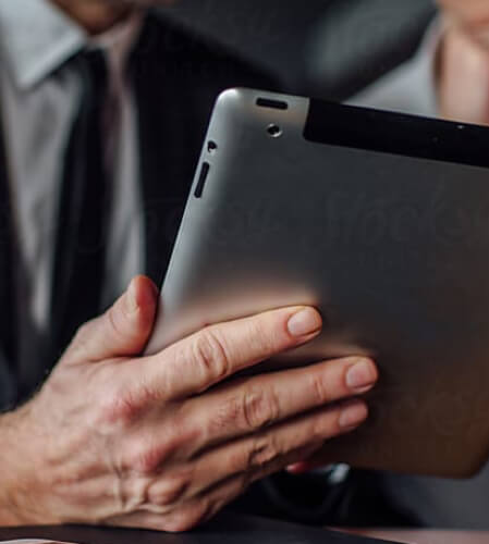 Hand holding a tablet device