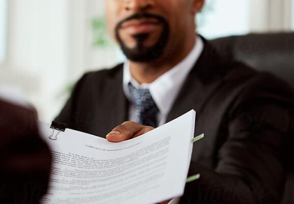Man handing off papers