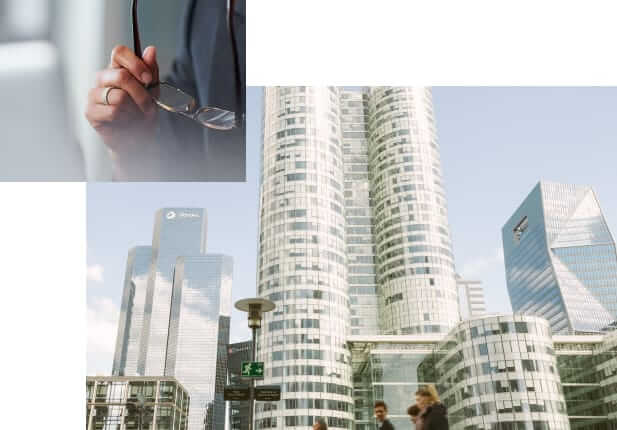 Composite image including close-up photo of hands holding glasses and skyscrapers