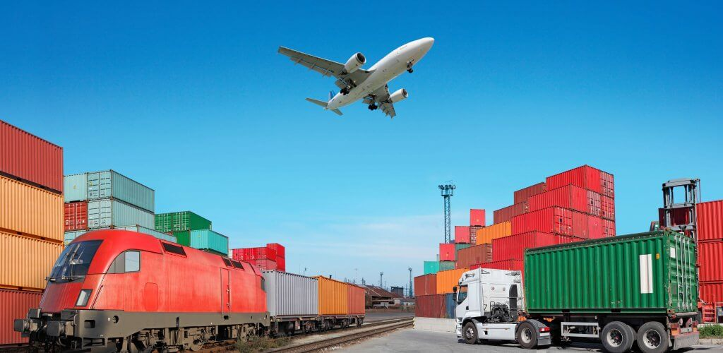 Storage containers with airplane flying overhead.