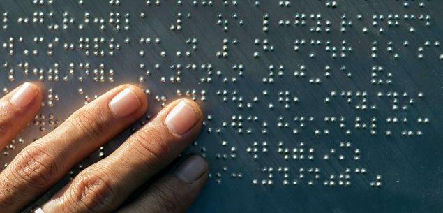 Hand reading braille.