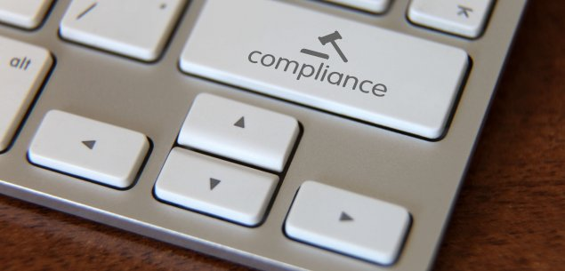 "Keyboard with key that says ""Compliance"" with icon of a gavel."