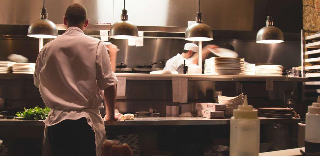 Cooks in restaurant kitchen.