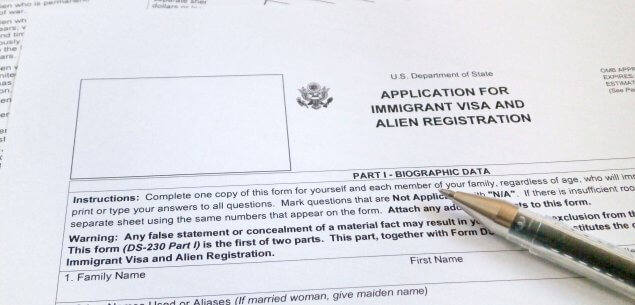 Immigration application with pen.