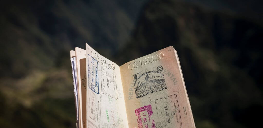 Person holding open passport book.