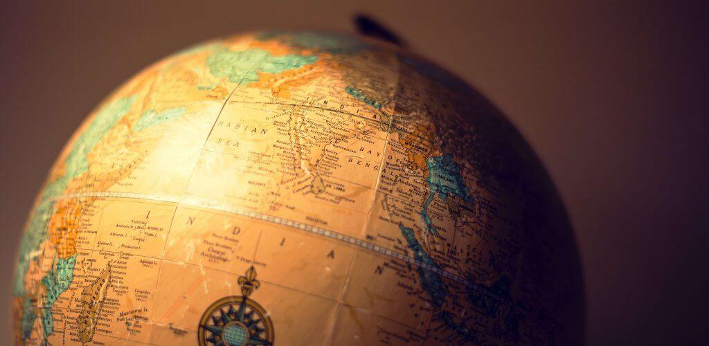 Sepia-tinted world globe.