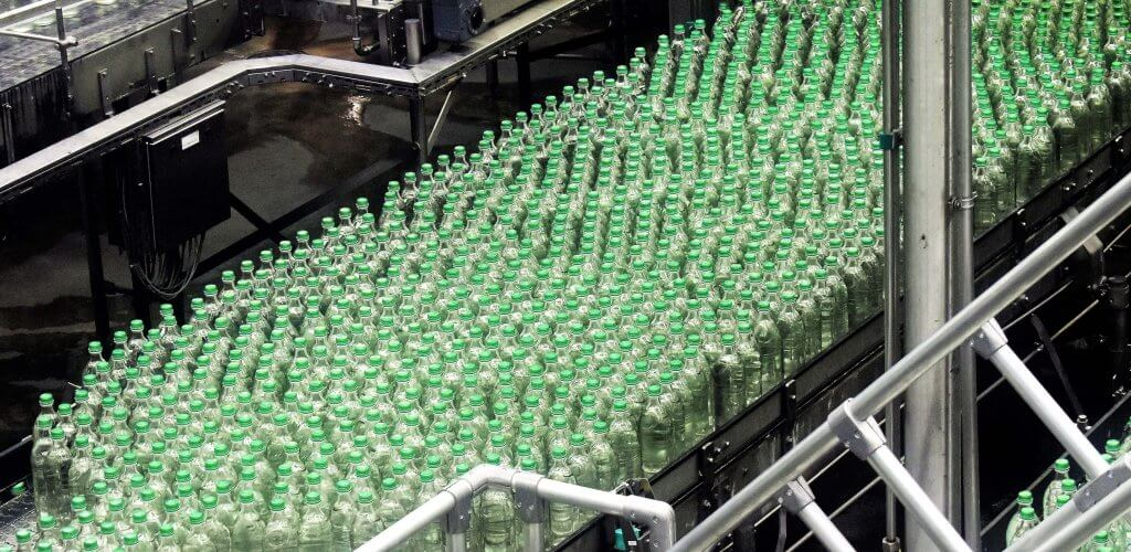 Assembly line with bottles.
