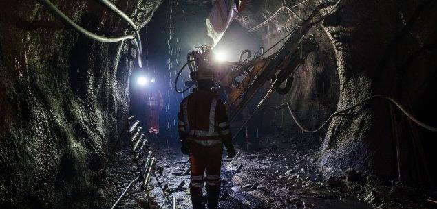 Man walking down a dark mine shaft
