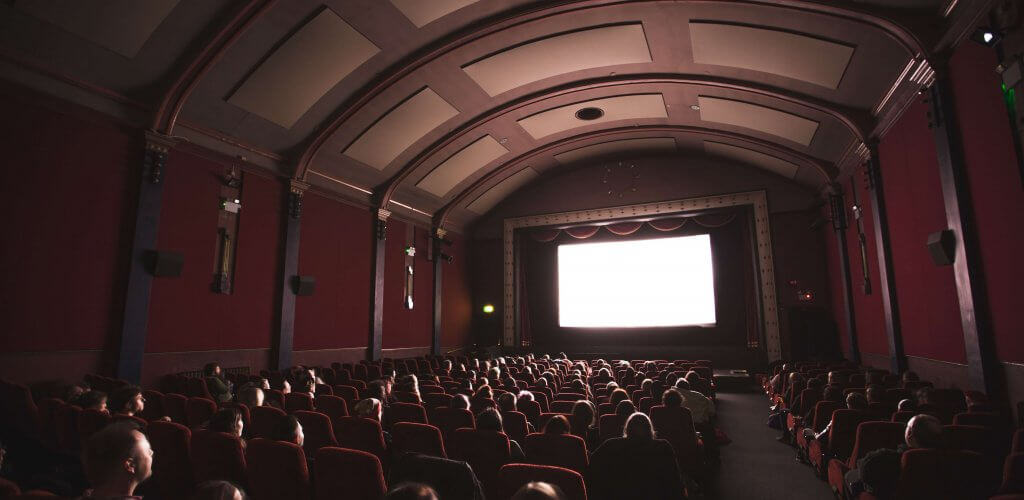 Movie theater filled with people.