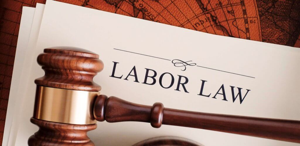 "Document titled ""Labor Law"" with gavel on top."