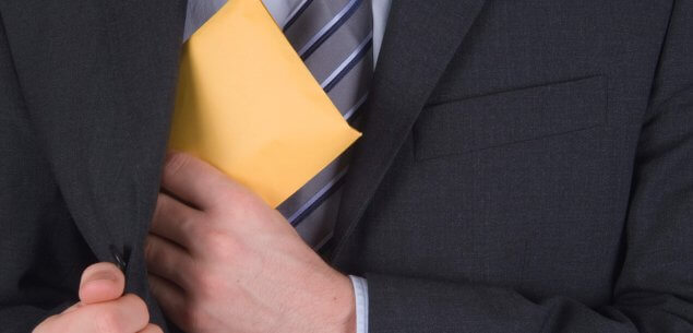 Person putting folder in to jacket.