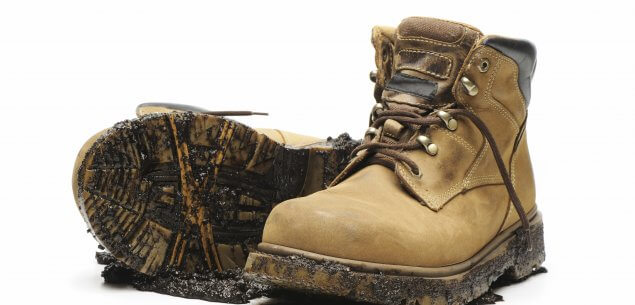 Image of dirty steel-toe work boots
